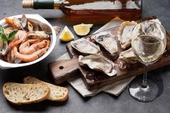 Fresh seafood and white wine. On stone table Stock Photo