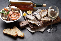 Fresh seafood and white wine on stone table Royalty Free Stock Image