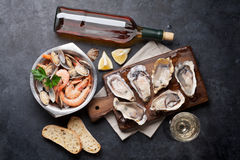 Fresh seafood and white wine on stone table Stock Photo