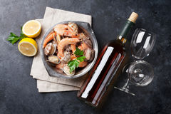 Fresh seafood and white wine. On stone table. Top view Stock Image