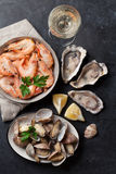 Fresh seafood and white wine. On stone table. Top view Stock Photography
