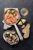 Fresh seafood and white wine. On stone table. Top view Royalty Free Stock Photos