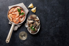 Fresh seafood and white wine. On stone table. Top view with copy space Royalty Free Stock Photography