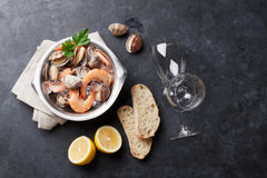 Fresh seafood and white wine. On stone table. Top view with copy space Stock Photos