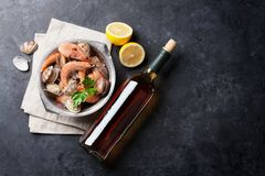 Fresh seafood and white wine. On stone table. Top view with copy space Stock Photography