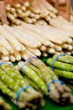 Fresh seasonal asparagus on market Stock Images