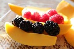 Fresh seasonal berries and mango Stock Photo