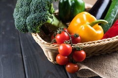 Fresh seasonal vegetables in basket on rustic wooden table Royalty Free Stock Photo