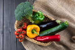 Fresh seasonal vegetables in basket on rustic wooden table Royalty Free Stock Photography