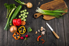 Fresh seasonal vegetables and knife on rustic wooden background Stock Photography