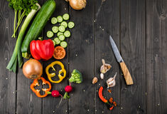Fresh seasonal vegetables and knife on wooden table background Stock Image