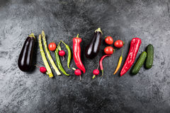 Fresh seasonal vegetables in row on black table top background Royalty Free Stock Images
