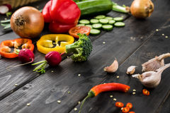 Fresh seasonal vegetables on rustic wooden background Royalty Free Stock Image