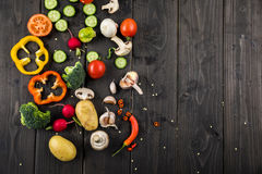 Fresh seasonal vegetables on rustic wooden background Stock Photography