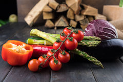 Fresh seasonal vegetables on rustic wooden table Royalty Free Stock Images