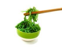 Fresh seaweed salad on white plate Stock Photo