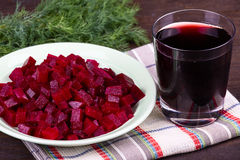 Fresh segments of a beet and beetroot juice Royalty Free Stock Photo