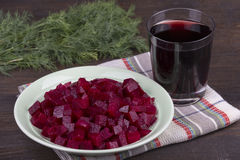 Fresh segments of a beet and beetroot juice Stock Photo