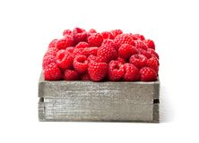 Fresh  selected raspberries  on wooden box isolated on white. Fresh  selected raspberries on wooden box isolated on white Royalty Free Stock Photos