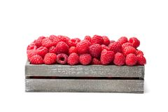Fresh  selected raspberries  on wooden box isolated on white. Fresh  selected raspberries on wooden box isolated on white Stock Photos