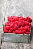 Fresh  selected raspberries on  wooden box on wooden table. Fresh  selected raspberries on wooden box on wooden table Stock Photography