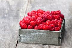 Fresh  selected raspberries  on wooden box on wooden table. Fresh  selected raspberries on wooden box on wooden table Royalty Free Stock Photo