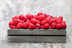 Fresh  selected raspberries on  wooden box on wooden table. Fresh  selected raspberries on wooden box on wooden table Royalty Free Stock Photos