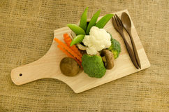 Fresh shitake mushroom,broccoli and green pea on wooden board Stock Photography