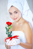 Fresh from Shower Woman Holding Rose and Presents Stock Photography