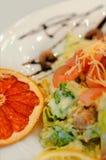 Fresh shrimp salad with chocolate sauce. Fresh shrimp salad with cheese and chocolate sauce Royalty Free Stock Photos
