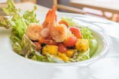 Fresh Shrimp Salad with iceberg lettuce and tomato Stock Image