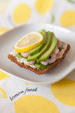 Fresh shrimps, avocado, cream cheese and lemon on a slice of rye bread. Royalty Free Stock Images