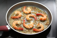 Fresh shrimps being fried on a pan Royalty Free Stock Photo