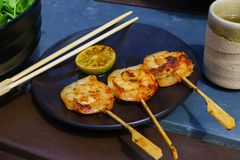 Fresh shrimps, fried on skewers Thai style food royalty free stock photos