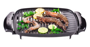 Fresh shrimps on a grill. Stock Photography