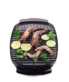 Fresh shrimps on a grill. Stock Images