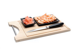 Fresh shrimps and ingver on wooden board Royalty Free Stock Photography