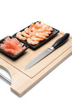Fresh shrimps and ingver on wooden board Stock Photo