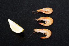 Fresh shrimps with lemon. Royalty Free Stock Photography