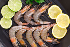 Fresh shrimps with lemon and parsley. Stock Photography