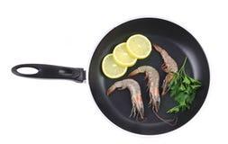 Fresh shrimps on pan with lemon. Stock Photography