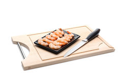 Fresh shrimps on wooden board isolated. Royalty Free Stock Image