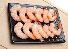 Fresh shrimps on wooden board isolated. Stock Photos