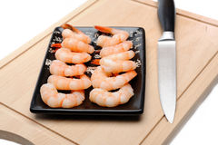 Fresh shrimps on wooden board isolated Stock Photography