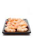 Fresh shrimps on wooden board isolated Stock Photo