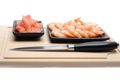 Fresh shrimps on wooden board isolated Royalty Free Stock Photos