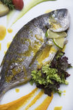 Fresh silver bream served with poached potatoes and two different vegetable puree 3top view Royalty Free Stock Photos
