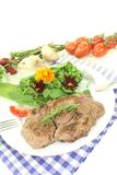Fresh Sirloin steak with wild herb salad Royalty Free Stock Image