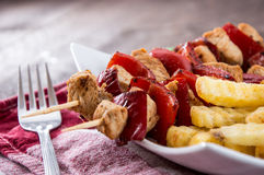 Fresh Skewer with french fries Stock Photo