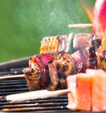 Fresh skewers on the grill. Stock Photo